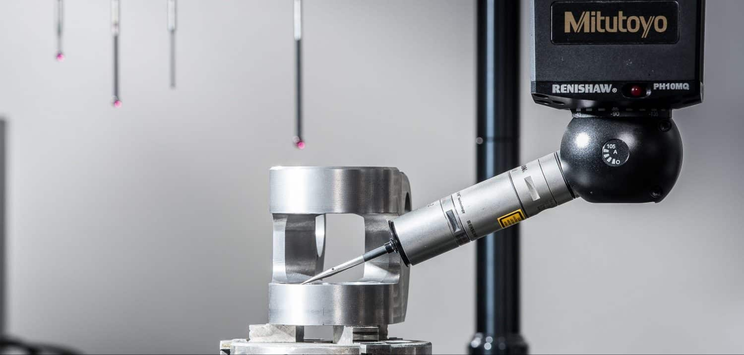 close up of a renishaw PH10MQ coordinate measuring machine (CMM) and high precision aluminium part